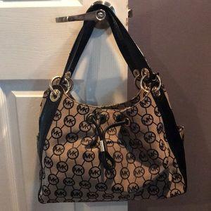 Michael Kors Black and Tan shoulder bag.